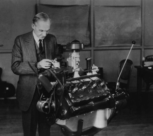 "HENRY FORD WITH ENGINE.  Henry Ford shocked the automotive world 60 years ago by doing the impossible -- mass-producing the V-8 engine.  Here he is shown with his first ""production"" engine which is now displayed in the Henry Ford Museum in Dearborn MI.  A brass tag on the first engine reads:  ""This is V-8 No. 1 motor.  Hold for Mr. H. Ford."" ************** From The collections of Henry Ford Museum/Greenfield Village and Ford Motor Company.  **************"